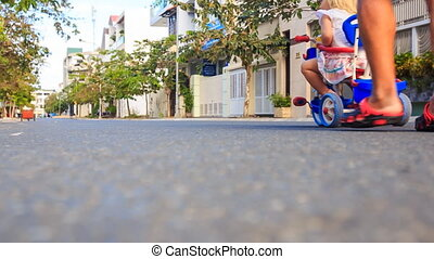 Backside Grandpa Pushes Tricycle with Girl Reads Ipod -...