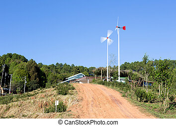 Windmills along the contry road in blue sky
