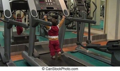 Child works out on running machine