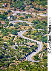 Island of Vis curvy road vertical view, Dalmatia, Croatia