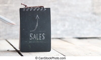 SALES word and arrow