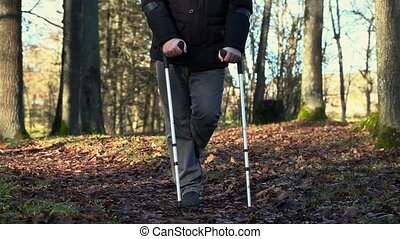 Disabled man on crutches at outdoor