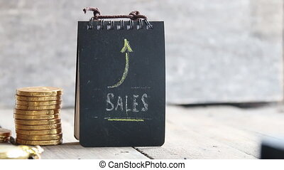 SALES word, coins and arrow