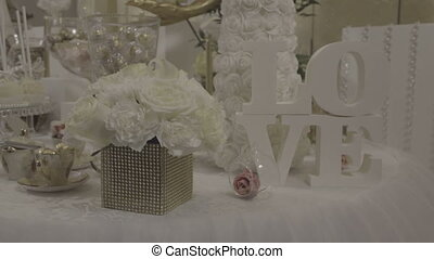 Flowers and letters in the decor - Details of the wedding,...