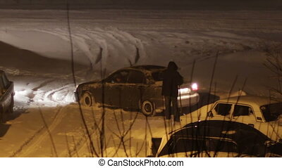 The Car is Parked in the Winter in Bad Weather. - Blizzard,...