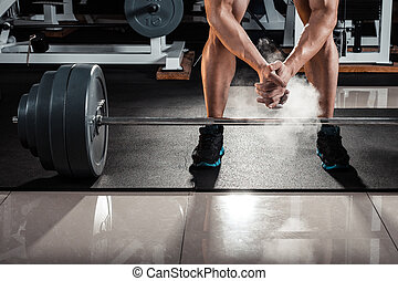 Young athlete getting ready for weight lifting training