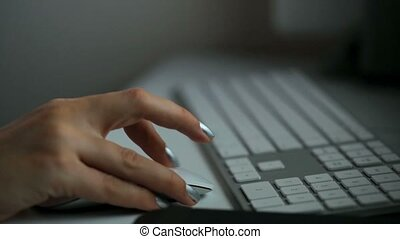 Woman hand clicking mous - Closeup of woman hand clicking...