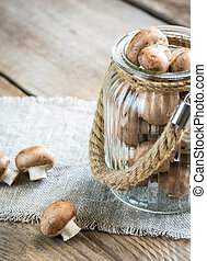 Brown champignon mushrooms on the wooden background - Brown...