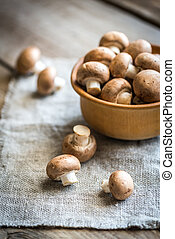 Bowl of brown champignon mushrooms - Brown champignon...