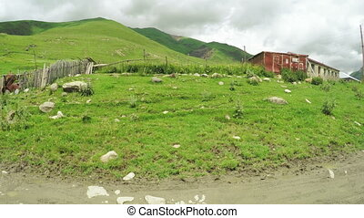 Mountain village near river - Svan village in mountains of...