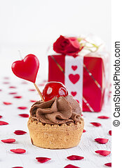 Cupcake in front of gift box
