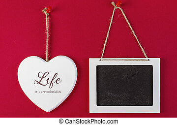 Love heart and emty blackboard on red