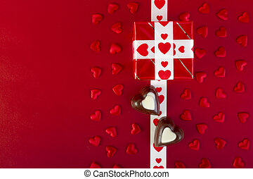 Gift and chocolate and red hearts