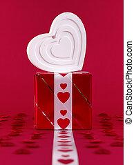 White shape heart over gift box