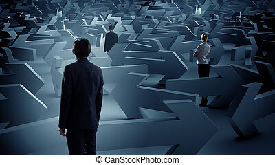 Businesspeople lost in maze - Confused businesspeople in...