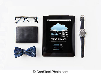 tablet pc with weather cast and personal stuff - technology...
