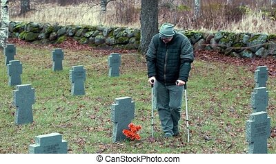 Disabled veteran  in graveyard.