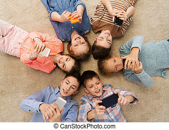 happy smiling children lying on floor in circle - childhood,...