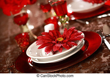 Luxury place setting in red and white for Christmas or other...