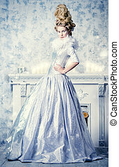 Ice Queen - Elegant young woman in a lush white medieval...