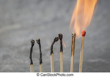 Row of burning matches
