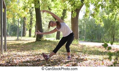 Attractive Woman stretching outdoor - Attractive Woman...