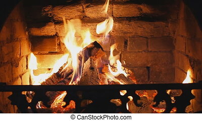 Wood burning in the fireplace - Dry wood burning in a...