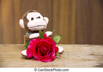 Monkey doll with red roses abstract background - Plush red...