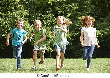 Group Of Children Running Towrads Camera In Playground
