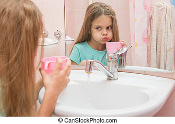 Girl rinse your mouth after brushing - Six year old girl...