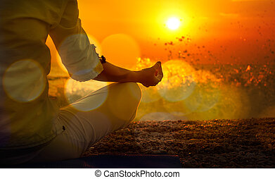 Woman Practicing Yoga by the Sea at Sunset. Beautiful Toned...