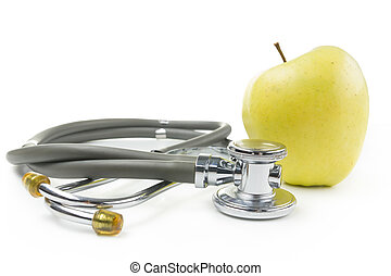 green apple and medical stethoscope. Medical costs, financial concept