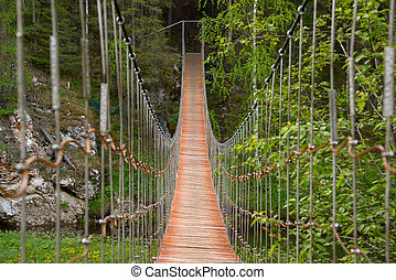 Suspension bridge - Wooden suspension bridge over the river...