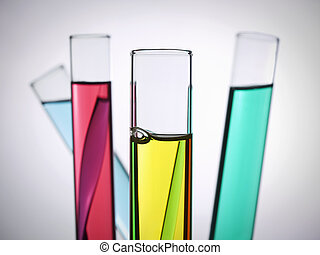 Test tubes - Four test tubes filled with colored liquids