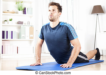 Fit Man Doing Press Up Exercise on a Fitness Mat - Fit Young...