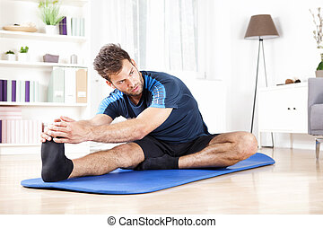 Man Performing Hamstring Stretch at Home