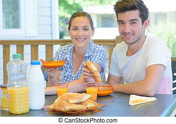 Couple eating continental breakfast