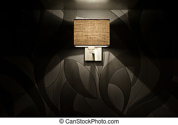 included wall lamp in the bedroom at the evening