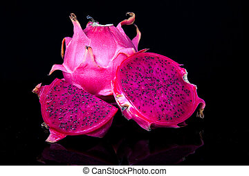 Fresh red dragon fruit with cut dragon fruit and slice on...