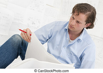 pn[5DNYS6S] Mechanical engineer checking drawings - Young...