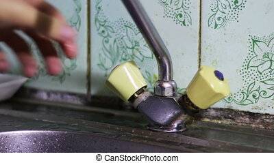 Open and Close the Tap Water - Man opens and closes the...