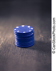Gambling chips, retro style color processing - Stack of blue...
