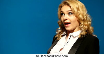 surprised business woman on blue background