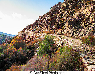 Ancient road in Calanques de Piana - One person walking on...