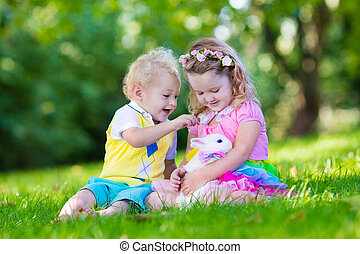 Kids playing with pet rabbit - Children play with real...