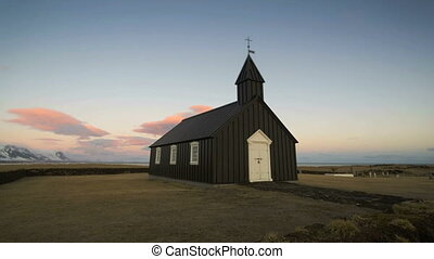 Time lapse of the church of Budir in Iceland, daytime