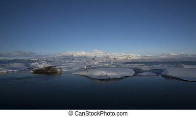 Time lapse of glacier lagoon - Time lapse of sunrise at...