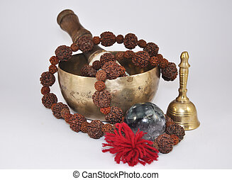 Tibetan Singing Bowl with beads, bells and a ball made of...