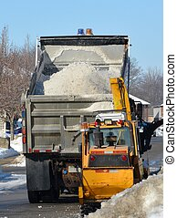 Snow removal - industrial snow thrower and city truck during...
