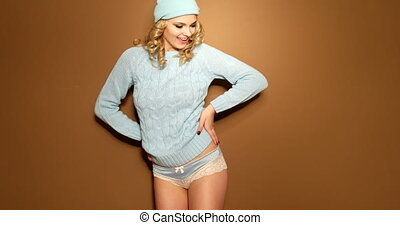 smiling blonde woman in winter jump